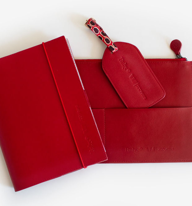 Ruby Westpac red journal luggage tag and holdall in collaboration with green collect